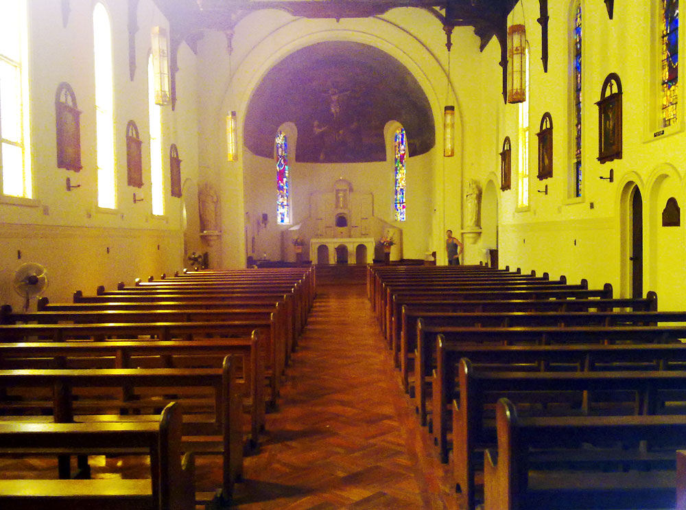 Interior of a church empty but for one man