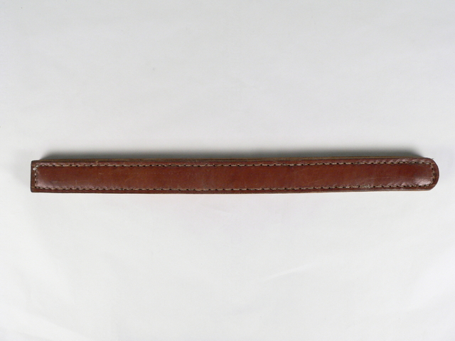 Image of a long, thin, brown leather strap with hand stitching around the edge