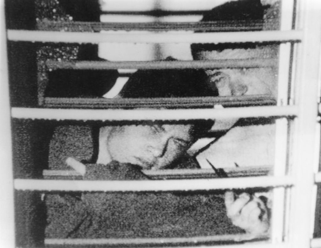 Two boys seen through bars across a window at Westboork Boys Home